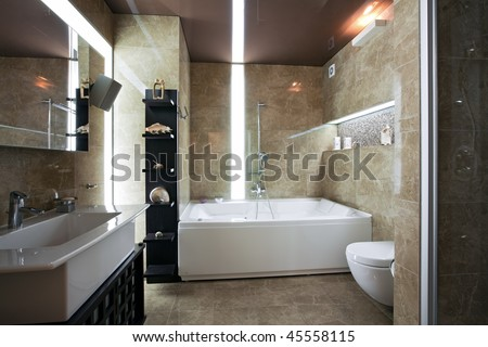 Interior of modern luxury bathroom with unusual lighting - stock photo