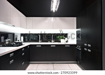 Interior of modern luxury kitchen in private house. - stock photo