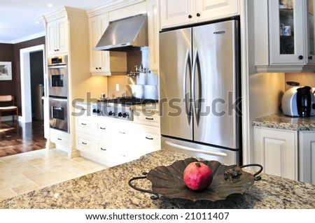 Interior of modern luxury kitchen with stainless steel appliances - stock photo