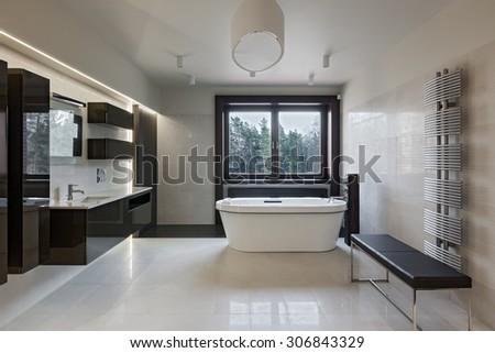 Interior of modern luxury minimalistic bathroom with window - stock photo