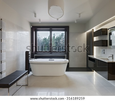 Interior of modern luxury minimalistic bathroom with window - stock photo