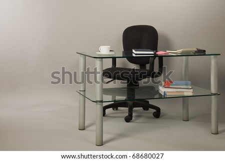 Interior of modern office with armchairs and glass table