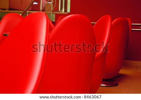 Interior of modern restaurant. Red leather and luxury chairs.