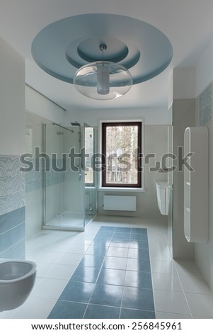 Interior of modern restroom with shower in blue colors - stock photo