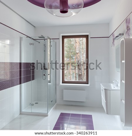 Interior of modern restroom with shower in pink colors