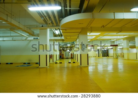 Interior of modern Underground Parking Lot Garage - stock photo