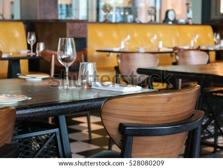 Interior Of Modern Vintage Restaurant, Empty Glasses Set On The Table.