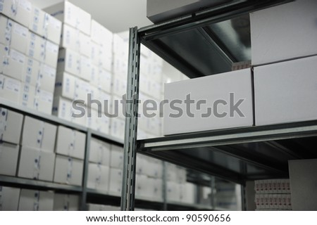 Interior of modern warehouse, many boxes - stock photo