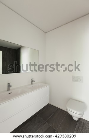 Interior of new apartment, white modern restroom