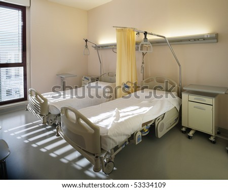 interior of new empty hospital room fully equipped - stock photo