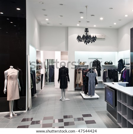 Interior of new fashion boutique in modern shopping mall - stock photo