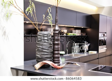 interior of new kitchen with modern vases - stock photo