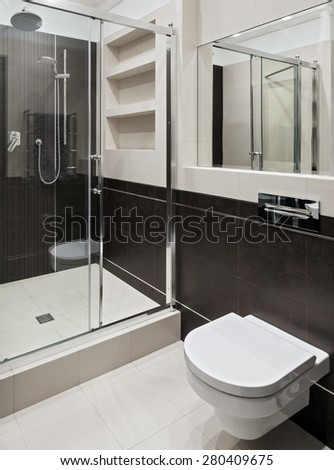 Interior of new modern bathroom with shower - stock photo
