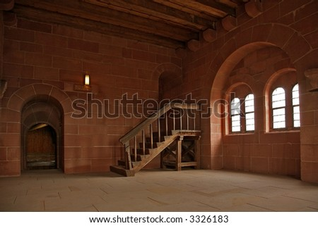 Interior of old castle with woody stairs