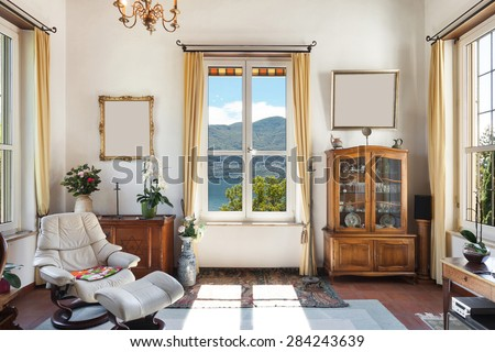 interior of old house, classic furniture, living room with window - stock photo
