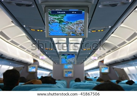 interior of passenger aircraft and screen - stock photo