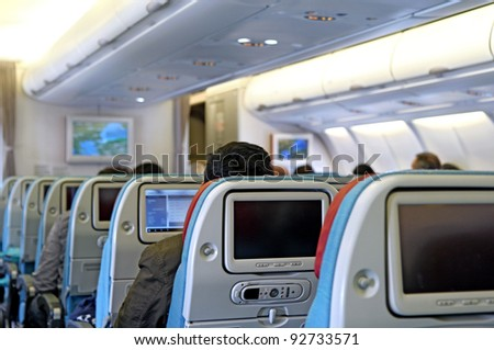interior of passenger airplane with the seats - stock photo