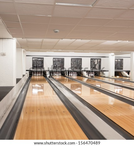 Interior of pins at the end of bowling alley - stock photo