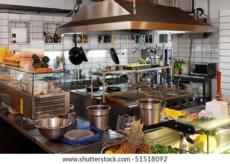 Interior of professional chef kitchen in restaurant - stock photo