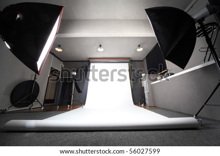 interior of professional photo studio with white background general view - stock photo