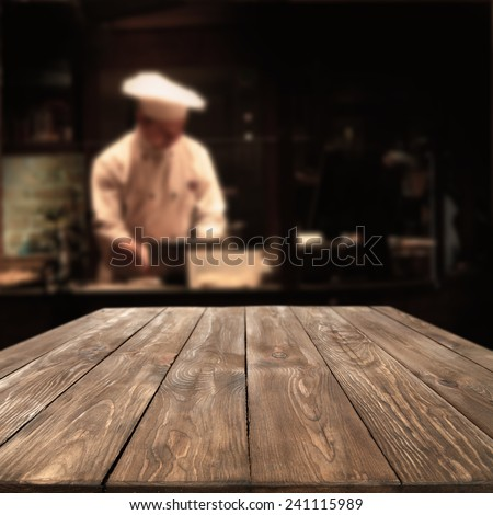 interior of restaurant and cook with worn old big table  - stock photo