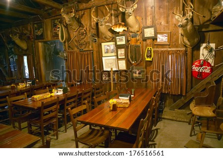 Interior of rustic old restaurant with hunting lodge - stock photo