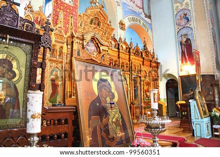 Interior of Saint Trinity Orthodox Convent in Riga, Latvia including Icon of Madonna Mother of God (Mary) and child (Jesus Christ). - stock photo