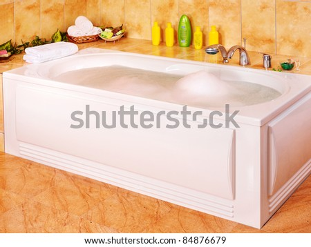 Interior of sauna tub with candle. - stock photo