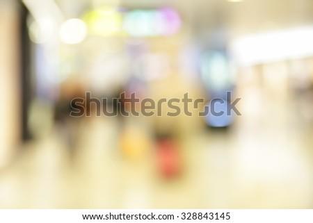 Interior of shopping center - defocused blured background - stock photo