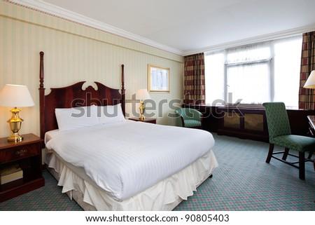 Interior of simple hotel room - stock photo