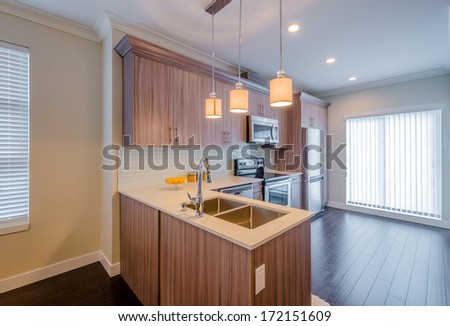 interior of small white kitchen with yellow lemons on the table - stock photo