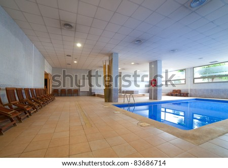 Interior of  spa hotel with  swimming pool - stock photo