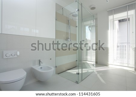 Interior of spacious, bright and modern bathroom - stock photo