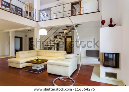 Interior of the big and modern designer's house - stock photo