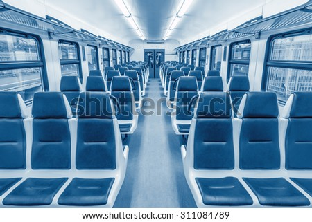 Interior of the empty passenger carriage of the train. - stock photo
