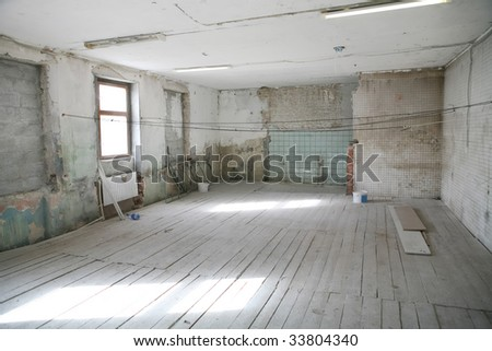 interior of the empty room with floor from wooden boards in old building
