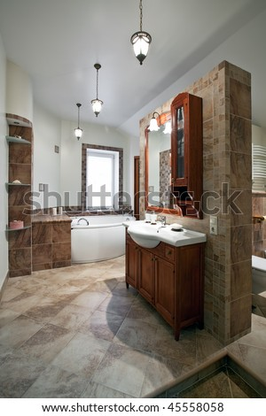 Interior of the luxury bathroom with red wood furniture and window - stock photo