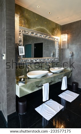 Interior of the luxury modern bathroom with marble floor and some decoration.  - stock photo