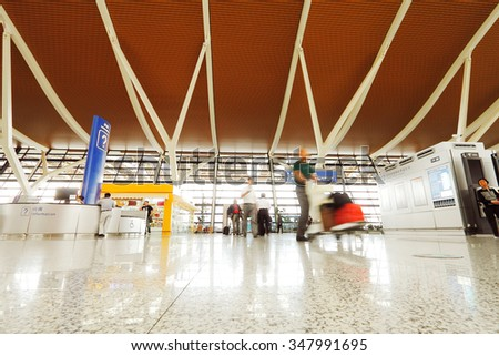 interior of the modern architectural in shanghai airport. - stock photo