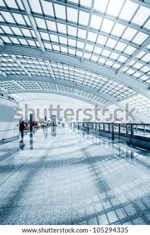 interior of the modern mall of beijin airport subway station. - stock photo