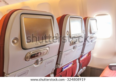 Interior of the passenger airplane - stock photo