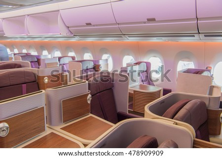 Interior of the passenger airplane. (business class seat)