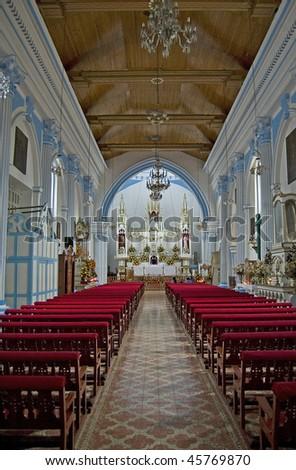 Interior of the Roman Catholic Santa Lucia Church in San Cristobal de las Casas Chiapas, Mexico - stock photo