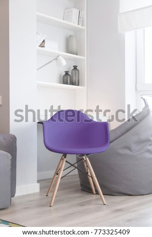 Interior of the room in light colors and a chair in color of the year 2018 pantone ultra violet
