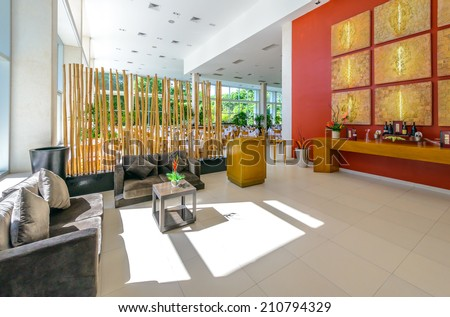 Interior of the tropical, caribbean restaurant with nicely served and decorated tables at the luxury resort. - stock photo