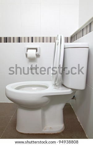Interior of Toilet seat and tissue paper in bathroom - stock photo