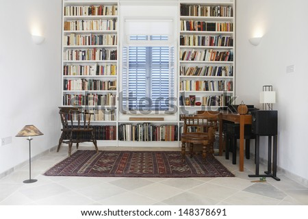 Interior of town house with books arranged in library - stock photo