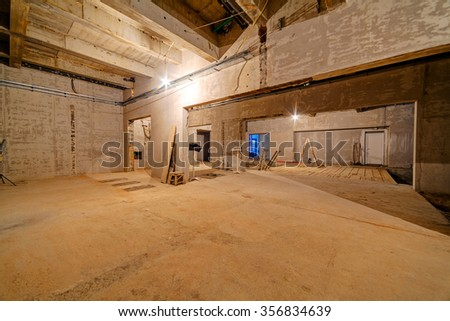 Interior of unfinished residential complex with concrete walls - stock photo
