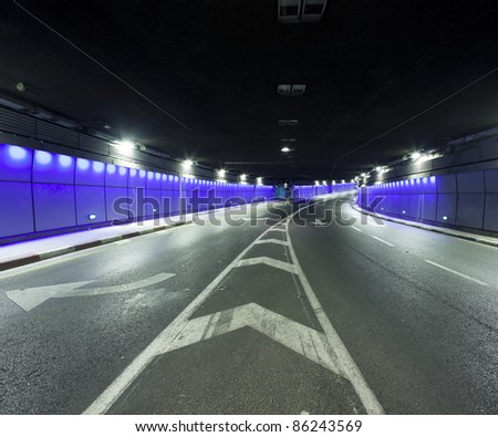 Interior of urban tunnel without traffic - This image was taken from three different shots - stock photo