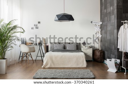 Interior of white and gray cozy bedroom - stock photo